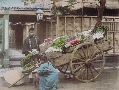 "Man selling vegetables in front of house. The coat of the grocery man is printed with the letters ""Inoue"". about 1890's by Ogawa,Kazumasa"