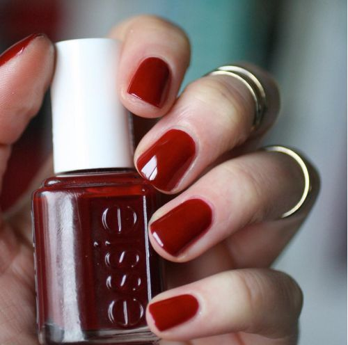 A classic deep red 'bordeaux' manicure never goes out of style.