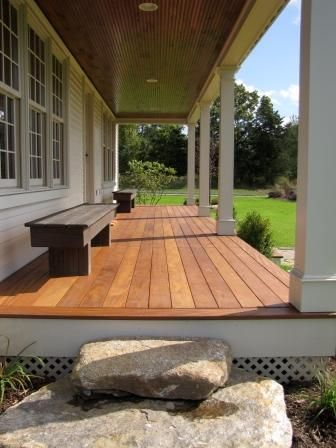 Covered porch with bead board ceiling.