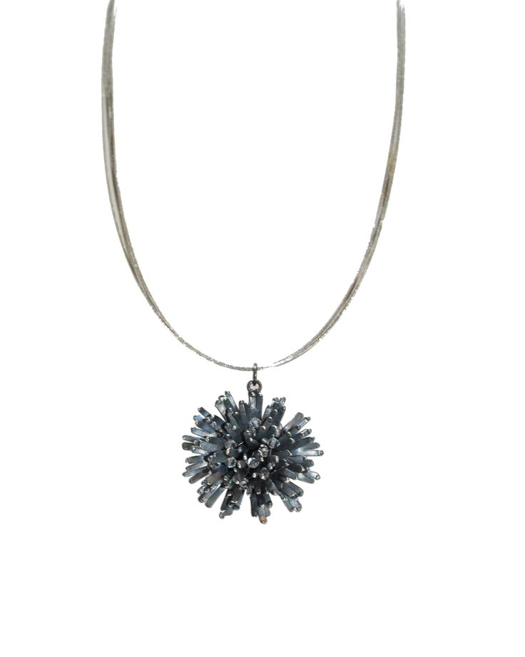 Oxidised sterling silver necklace that features small crystal beads that are woven into the center to create a sparkle. £390 #unusual #designer #necklace #London #NudeJewellery