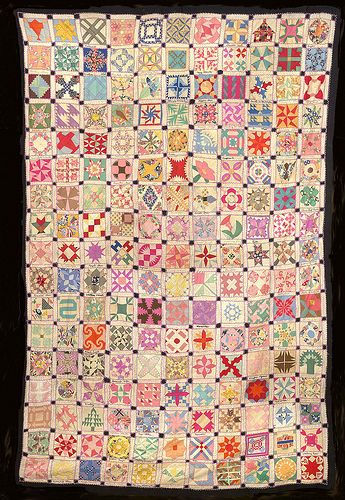 Dear Jane-ish  blocks.  In a unique Depression Era sampler quilt constructed of 187 little blocks with the name of each block embroidered in the sashing underneath it. by Gay at Sentimental Stitches.