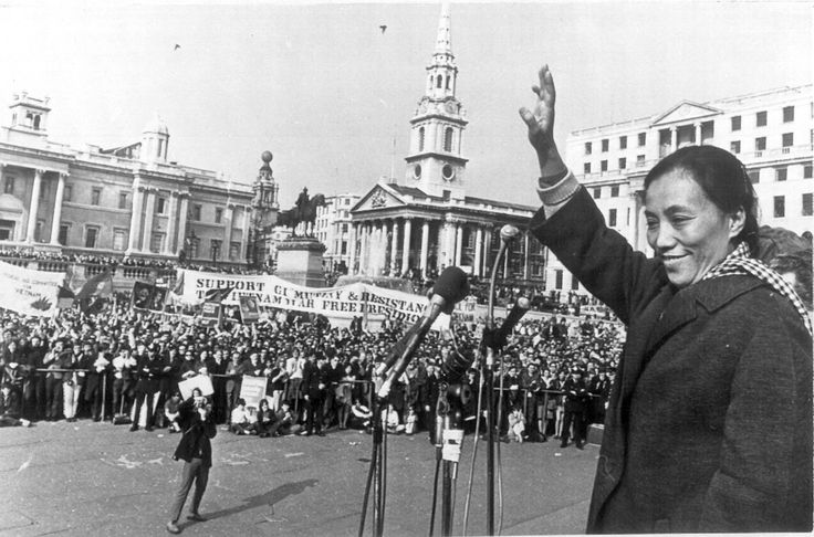 Madame Nguyen Thi Binh, deputy head of Vietnam's National Liberation Front delegation to the Paris peace talks, waves to the crowd gathered at London's Trafalgar Square, April 7, 1969. Several thousands of people attended the final stage of the annual Easter March from Cardiff to London, organized by the Campaign for Nuclear Disarmament, CND. Binh joined the march on the outskirts of London, accompanied by members of the British parliament. (AP Photo)