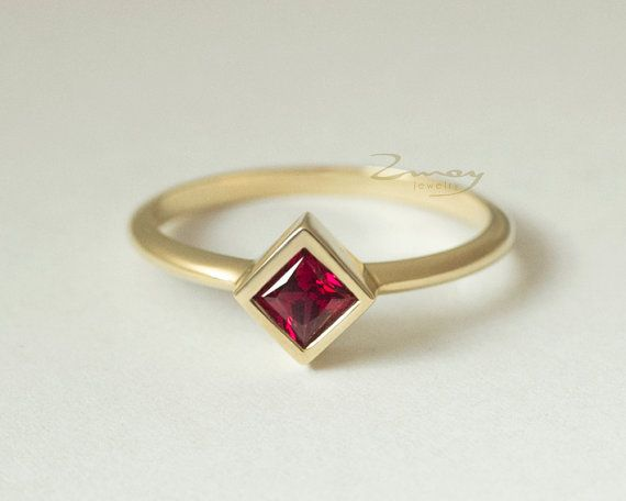 Product Specifications: Gemstone type: synthetic Ruby (other gemstones available priced upon request) Shape: Square Dimensions: 4 x 4 mm Setting: Bezel  Material: 14k solid yellow gold Band Width: 1.6 mm Band Thickness: 1.5 mm Finish: High polished  This ring can be entirely customized to your preferences (different stone, polished, brushed, matte finish or hammered). Feel free to contact us before purchase.  Sizes available: 3 - 10 (bigger and smaller sizes are available, priced upon…