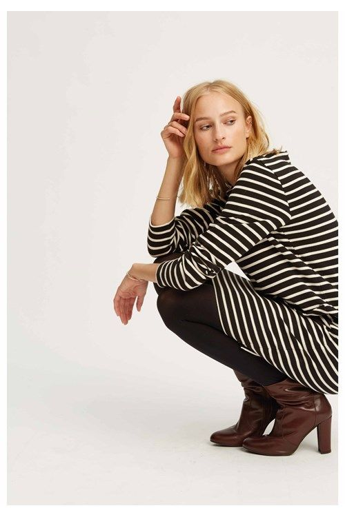 This nautical striped dress is made from a weighty organic cotton which holds its shape. The shift style dress has a slight dipped hem at the back and relaxed fit that's perfect for everyday wear. Try yours with tapered trousers by day and tights with ankle boots by night.