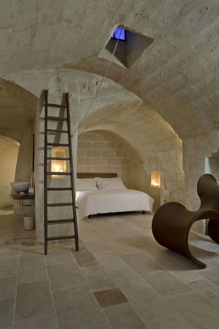 Corte San Pietro by Daniela Amoroso ,stone arches  coupled with warmth of modern wood
