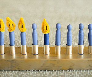 """Clothespin Menorah: Even little kids will be able to """"light"""" this flameless menorah—after they help craft it, of course."""