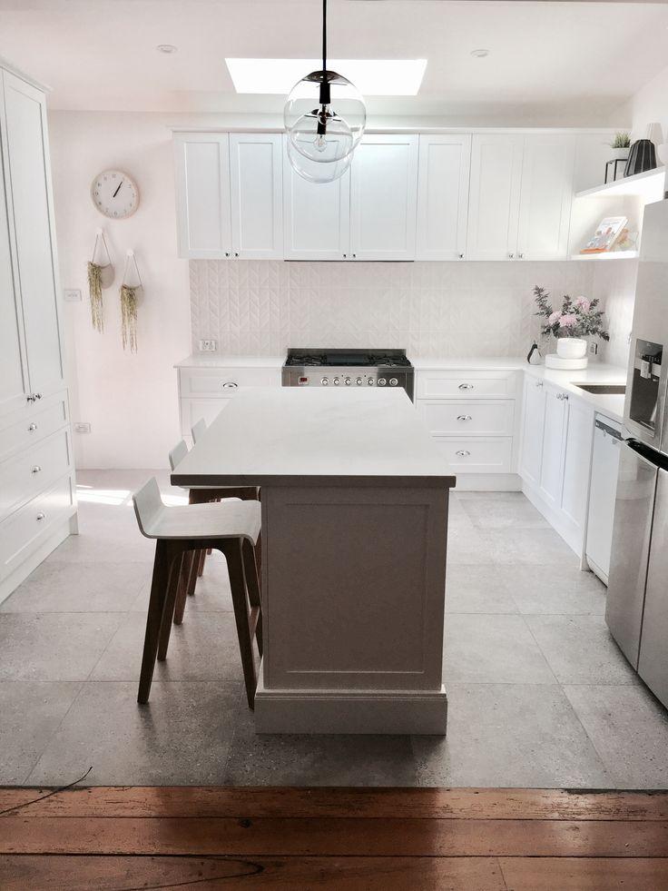 White kitchen grey floor tile.