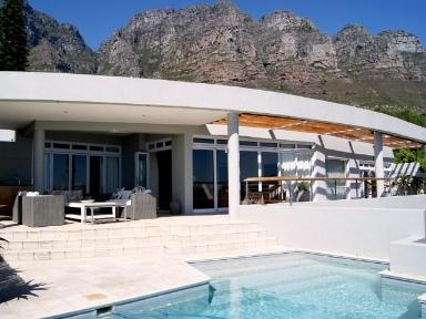 Modern Architecure with mountain backdrop and sea views