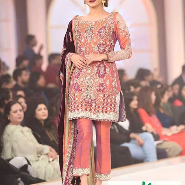 Absolutely stunning #Neha on stage posing for the Camera in a full swing styled by #Nabila in Our #NehShikaar Collection for #BCW15 To book appointment today please visit us at 44-L, M.M Alam Road Gulberg Lahore or write us at nickienina@gmail.com #NickieNina #NehShikaar #Signaturestyle #BCW #HumTv #Bridalweek #embellishment #timelesscouture #elegant