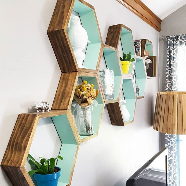 Still pinching myself over how amazing our #DIY honeycomb shelves turned out. These were such a great addition to the blank wall above our TV. They were Wyatt's idea and he did an awesome job crafting them. Then I had to add a splash of turquoise...o...
