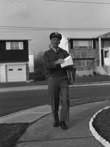 1950s Mailman Walking Outside Carrying Mail Looking At