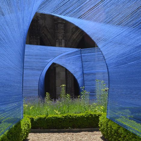 Paris studio Atelier YokYok created the Les Voûtes Filantes – or The Shooting Vaults – installation within the 16th-century Gothic-style cloister at St Stephen's Cathedral in Cahors, south-west France. Thin blue strings are stretched between arch-shaped frames to create tunnels across the cloister garden of the cathedral.