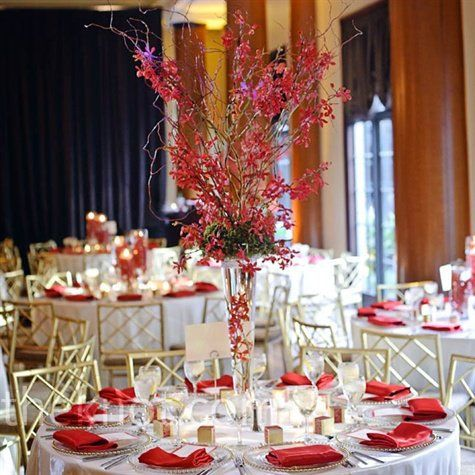 Tall mokara orchid centerpieces, shimmery red napkins, gold chairs and ivory table linens gave the space a modern eastern vibe.