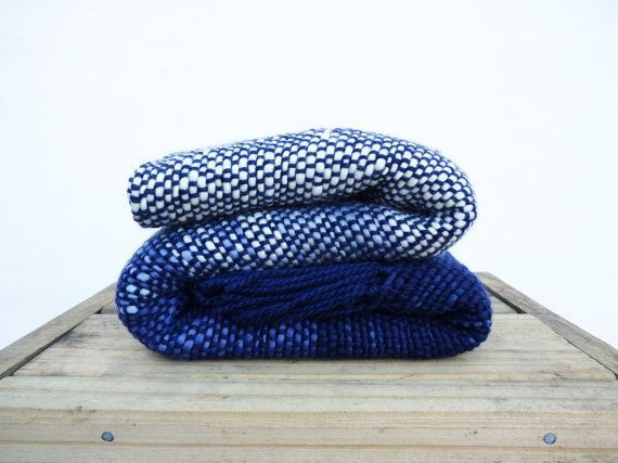 This Ocean wool sofa blanket have beautiful tones of blues and ecru colors. It is a handwoven wrap with chunky handspun wool yarn that makes you