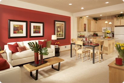 red, white and green living room with red accent wall. i like the contrast between  the red, white, and black
