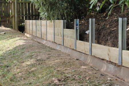 Easy to build SureWall retaining wall systems from Cirtex. The SureWall™ Retaining Wall Posts, provide a simple and easy solution for creating solid retaining walls and sleeper edging. This innovative system has significant labour savings due to minimum excavation and because there are no fasteners required this saves you time and money. One of the great features of the SureWall™ is the flush finish creating a smart, non-obtrusive wall. This also allows for easy garden maintenance.