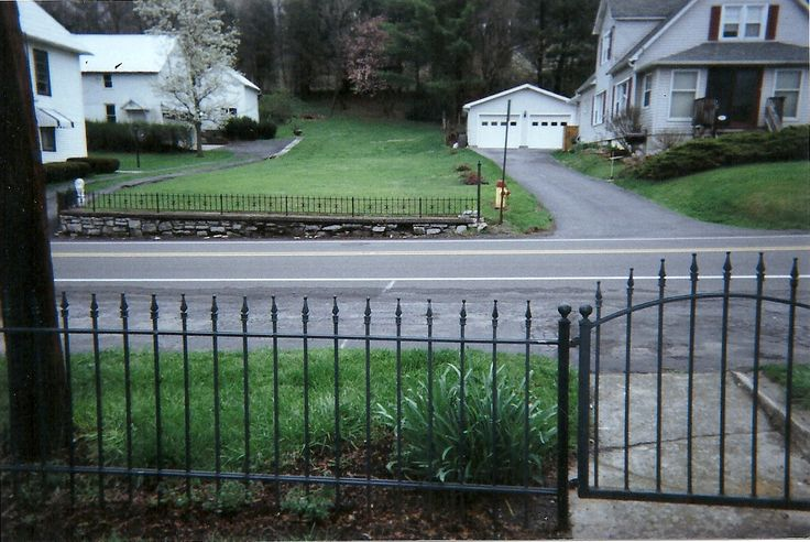 Wrought iron fence in front yard fencing pinterest for Small front yard ideas with fence