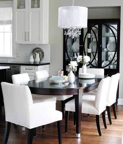 Style at Home - dining rooms - Benjamin Moore - Revere Pewter - Claremont Pendant, espresso, oval, dining table, white, parsons chairs, white, string, chandelier, black, cabinet, revere pewter,