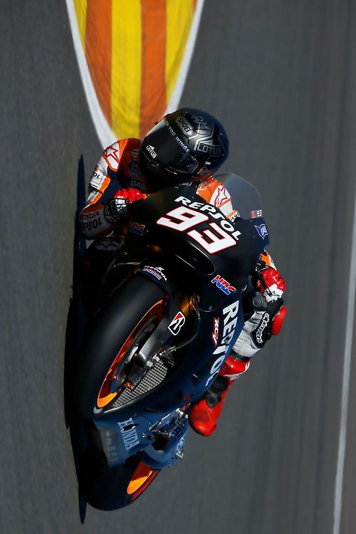 Marc Marquez at the Valencia MotoGP test- gives you a new perspective on how low they get.