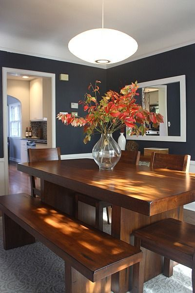 Beautiful combo of navy blue, rich wood dining room set, and red leaves