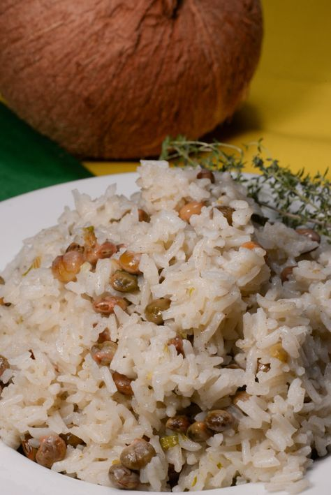 Jamaican coconut rice is a true staple food.  The addition of coconut milk while simmering the rice makes for a true tropical delight.  This rice can be made with either red beans or pigeon peas to be authentic.  It is served as side dish with everything, fish, chicken, goat etc.  I served ...