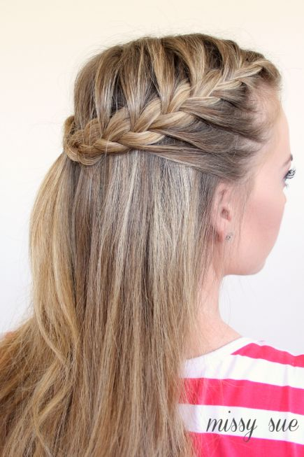 These braids are easy and adorable. Part down the middle, and French-braid the top layer of both sides. Bring the braids to meet in the middle, and secure with an elastic. #FrenchBraids #Hairstyles