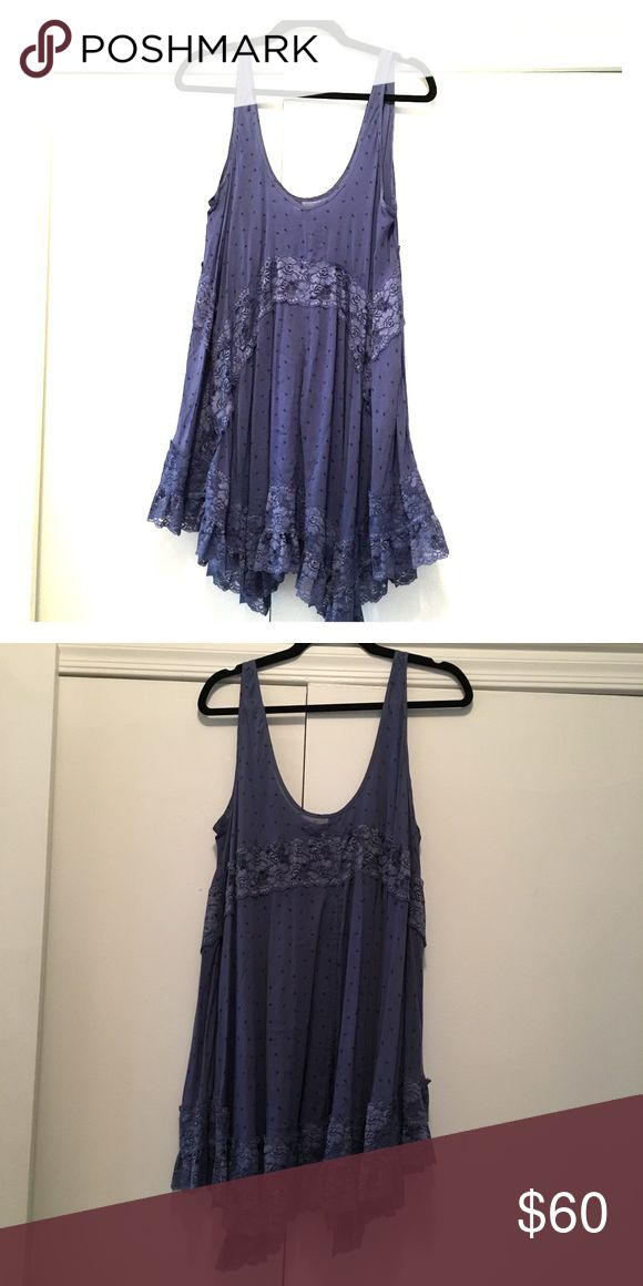 Free People Intimates Voile and Lace Trapeze Slip Gorgeous flowy slip, dress, or tunic. Super flexible and flattering design. Grape purple/blue color, Lace inserts, scoop neckline, pullover style. Size small. Only worn once!!! Free People Dresses