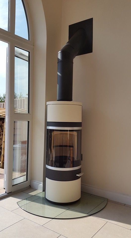 Scan 83 in brown with Ivory ceramic tiles, beautiful contrast, fantastic stove. Installed by Tettenhall Fireplaces