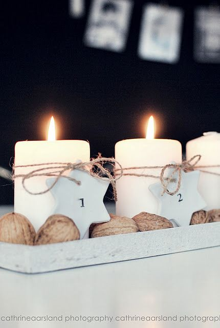 white candles, some plain string and walnuts