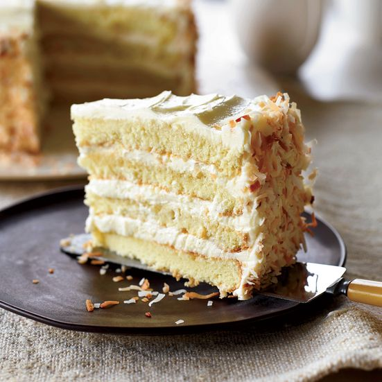 Chef Tyler Florence's amazing coconut layer cake at San Francisco's Wayfare Tavern is made with yellow cake and is filled and frosted with coconut buttercream.