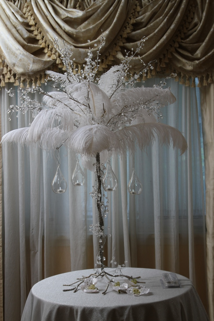 Crystal and Feather Centerpiece    www.magicbeyondmidnight.com    www.facebook.com/magicbeyondmidnight