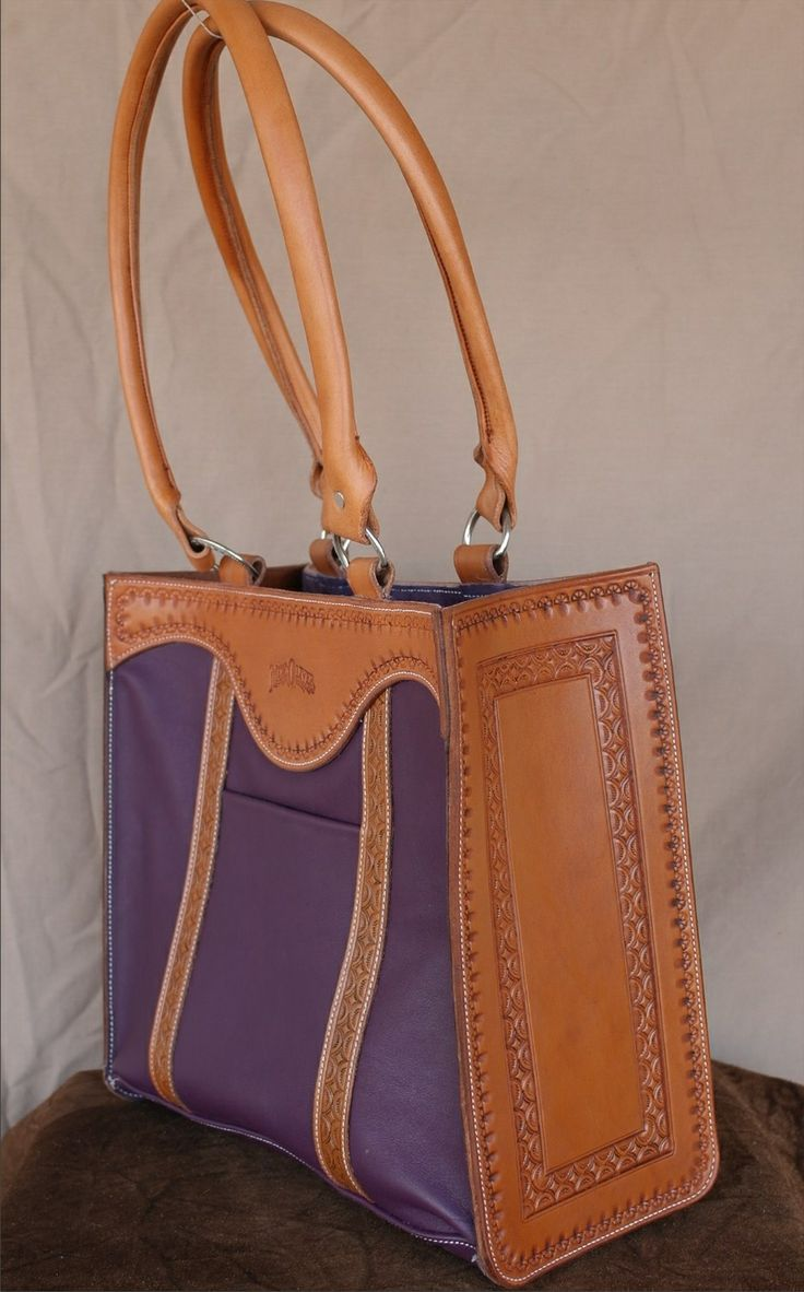 """Purple Tote This handsome bag is made for everyday use. Made of supple garment leather with tooled leather accents.  Measures 12"""" H x 12"""" W x 5"""" D"""