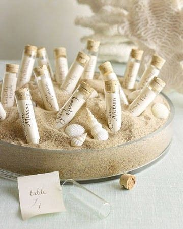 Beach Wedding Table Setting Idea - petite bottles tucked in the sand.