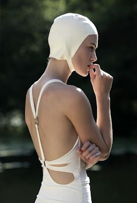 White swimsuit= disaster waiting to happen. Love the style of this one though.
