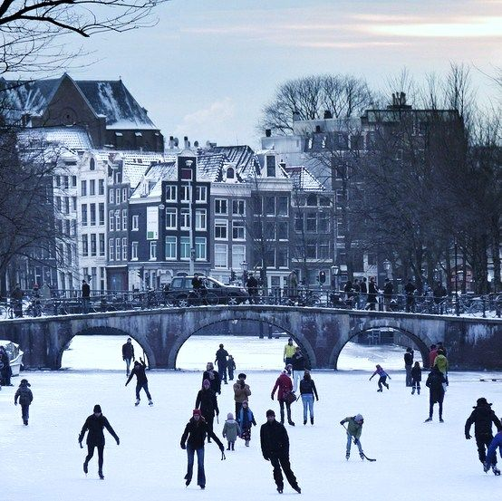 winter in Amsterdam. Ice skating in the canals