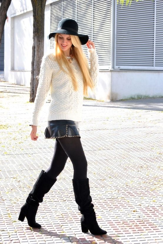 white knitted sweater with mini black leather skirt and long boots
