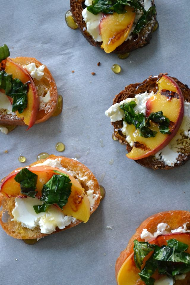 Crostini,grilled peaches & goat cheese. Drizzled with honey & topped with basil.
