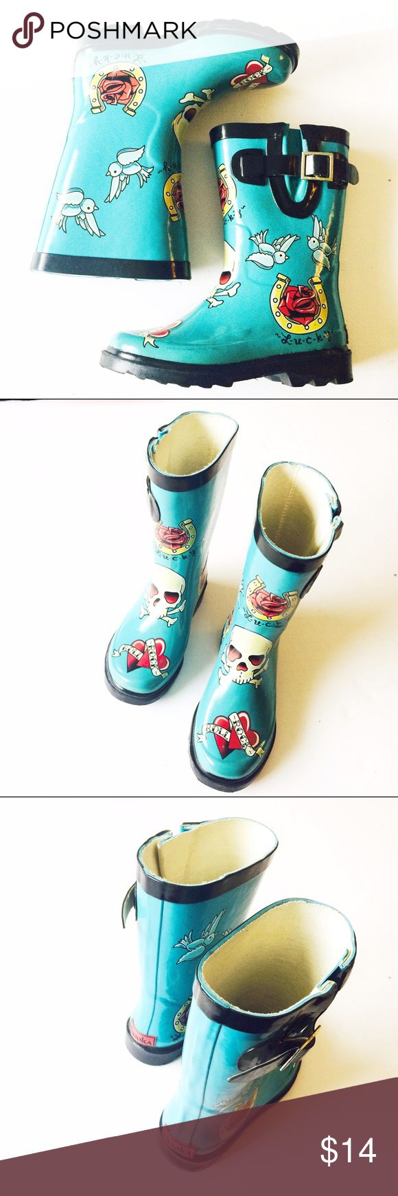 Chooka rain boots These adorable rain boots are perfect for a little rockabilly girl! Boots are in a great condition. Shoes Rain & Snow Boots