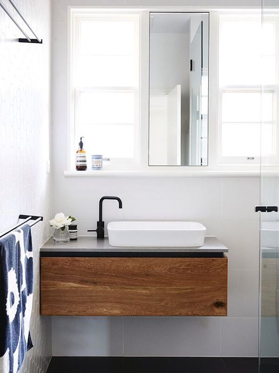 Black fixtures in the bathroom | Bathroom in the home of Mykayla Rose, photo by Eve Wilson via The Design Files.