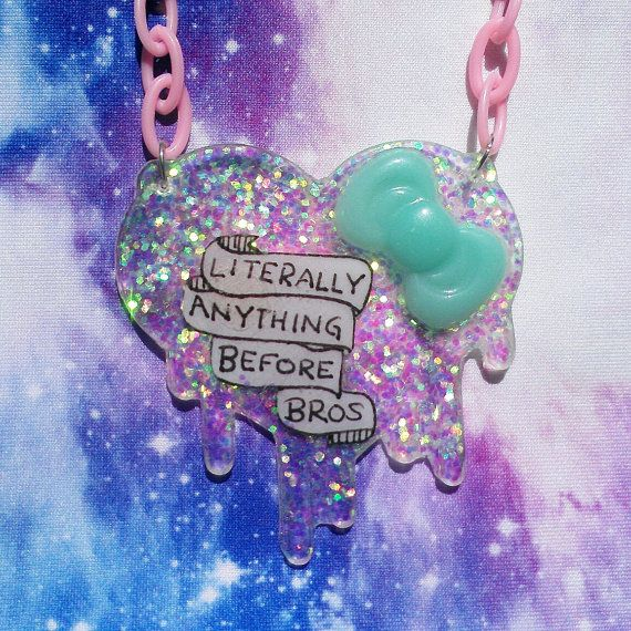 Handmade resin necklace says Literally Anything Before Bros across a hand-drawn scroll on a background of shimmering crystal glitter.  This necklace