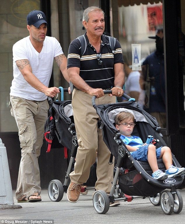 Three generations of Martins: Ricky Martin enlisted his father Enrique for stroller duty as he took his three-year-old sons Matteo and Valentino for pizza in Manhattan today