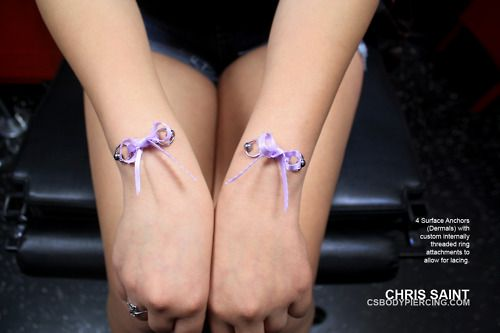 4 Surface Anchors (Dermals) on the wrist with custom ring attachments and laces