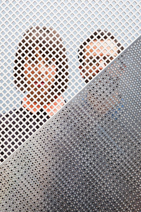 Intriguing Photographs Of People Shot Through Perforated Screens