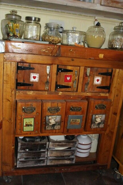Old wood,handles,tiles and cutlery became spice cupboard