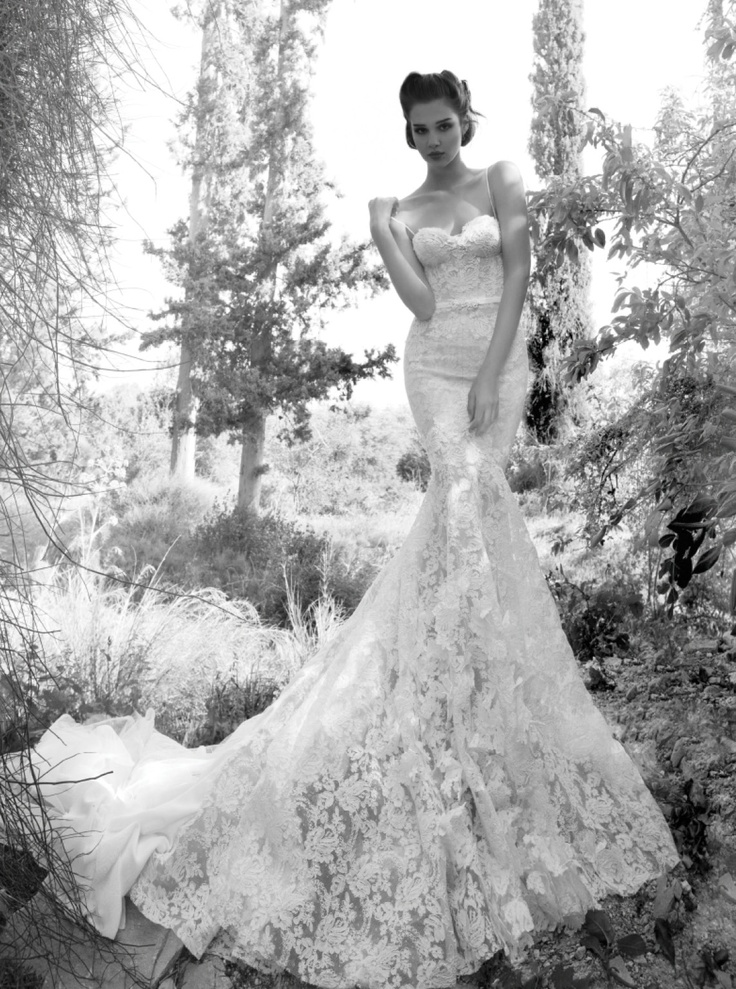 Perfect We are speechless over this Inbal Dror wedding dress The dramatic bunched lace train on this gown gives a sexy yet romantic charm