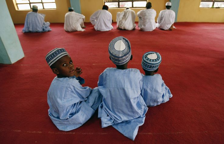 Children prepare for the prayers inside a mosque in the northern city of Katsina - #OilBook #Nigeria #Africa