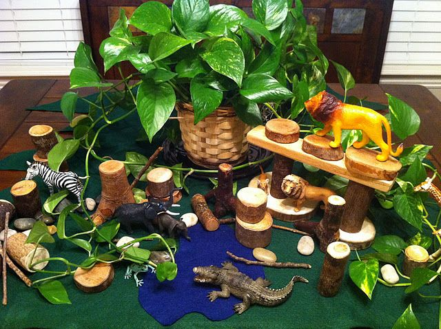 Block Center- create a jungle or other animal environment in your block center using tree blocks,  real or pretend plants, blue material symbolizing water, and plastic animals. Idea from The Imagination Tree: Small World Play