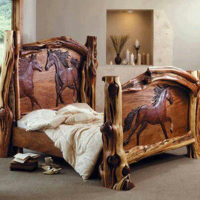 I love the horses carved into this wood bed frame.