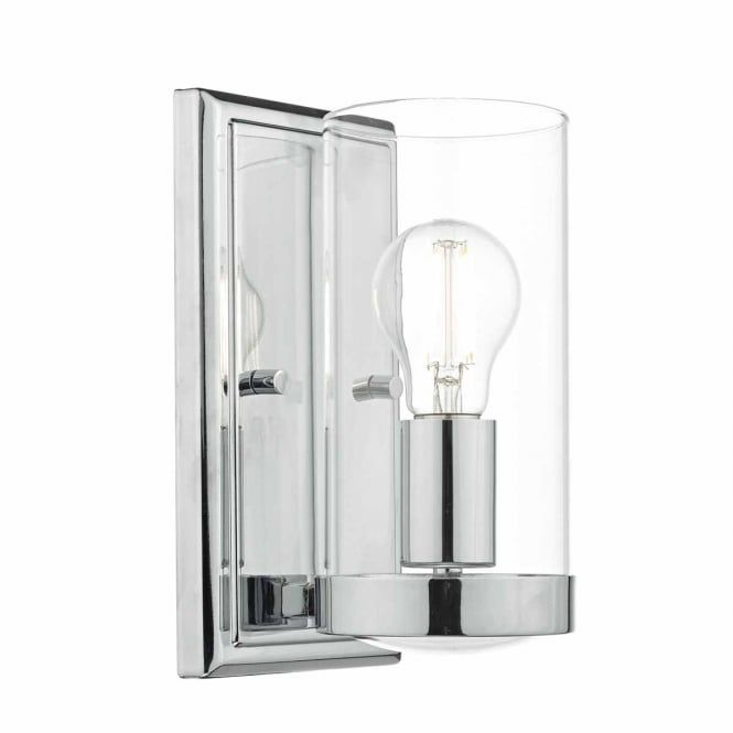 A modern design single wall light in a polished chrome finish with a clear glass cylindrical shade. This would be great for lighting in a contemporary lounge, bedroom or dining room. This light is double insulated for safe use without need of an earth wire. This light is individually switched by a pull cord.
