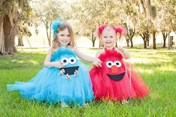 Our Sesame Street Inspired Tutus are too too cute! Everyone loves Elmo!  These costumes / tutu dresses are great for birthday parties, everyday playtime, parades, dances, shows or for halloween - my girls LOVE LOVE LOVE them!Made with tulle, each costume is sewn together on a coordinating ribbon that ties in the back. A tie is also added to tie around the neck - halter style. You can leave the halter ribbon down and let hang inside the dress, wear as a skirt, or wear the halter around the…